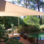 Beige Four Post Shade Sail over Pool