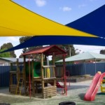 Coloured (Blue and Yellow) Shade Sails with Yellow Post Pads