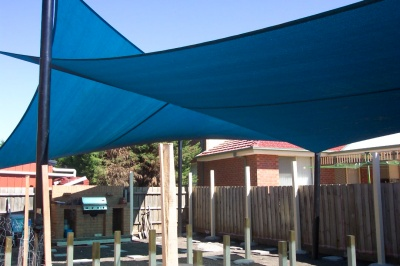 White Four Post Twisted Outdoor Entertainement Shade Sail