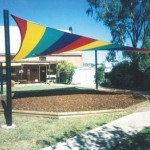 Rainbow coloured 4 post playground Shade Sail