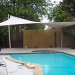 White Four Post Shade Sail over Swimming Pool